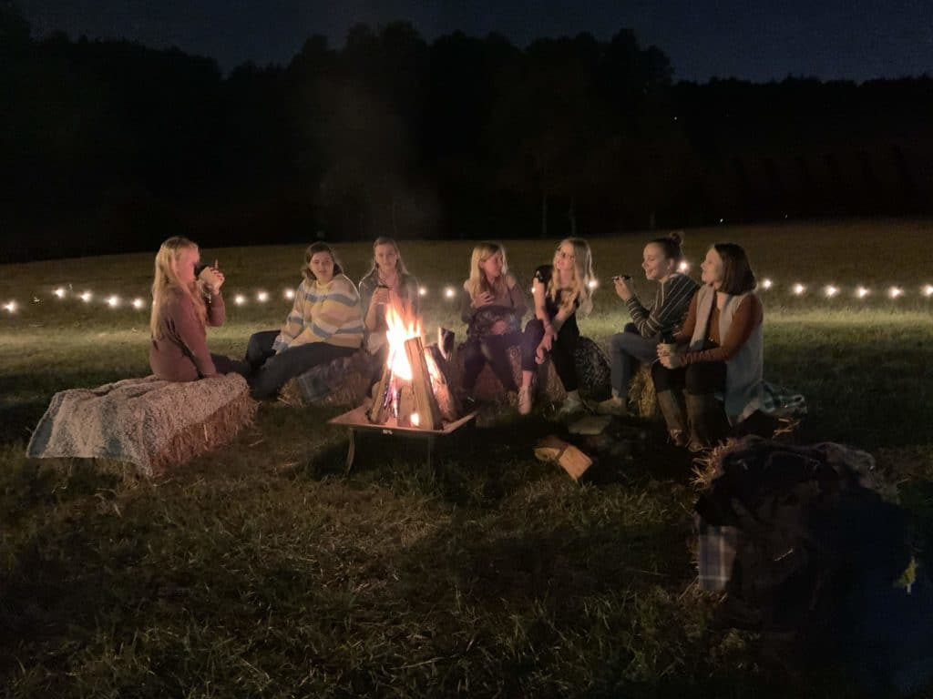 Students around a campfire
